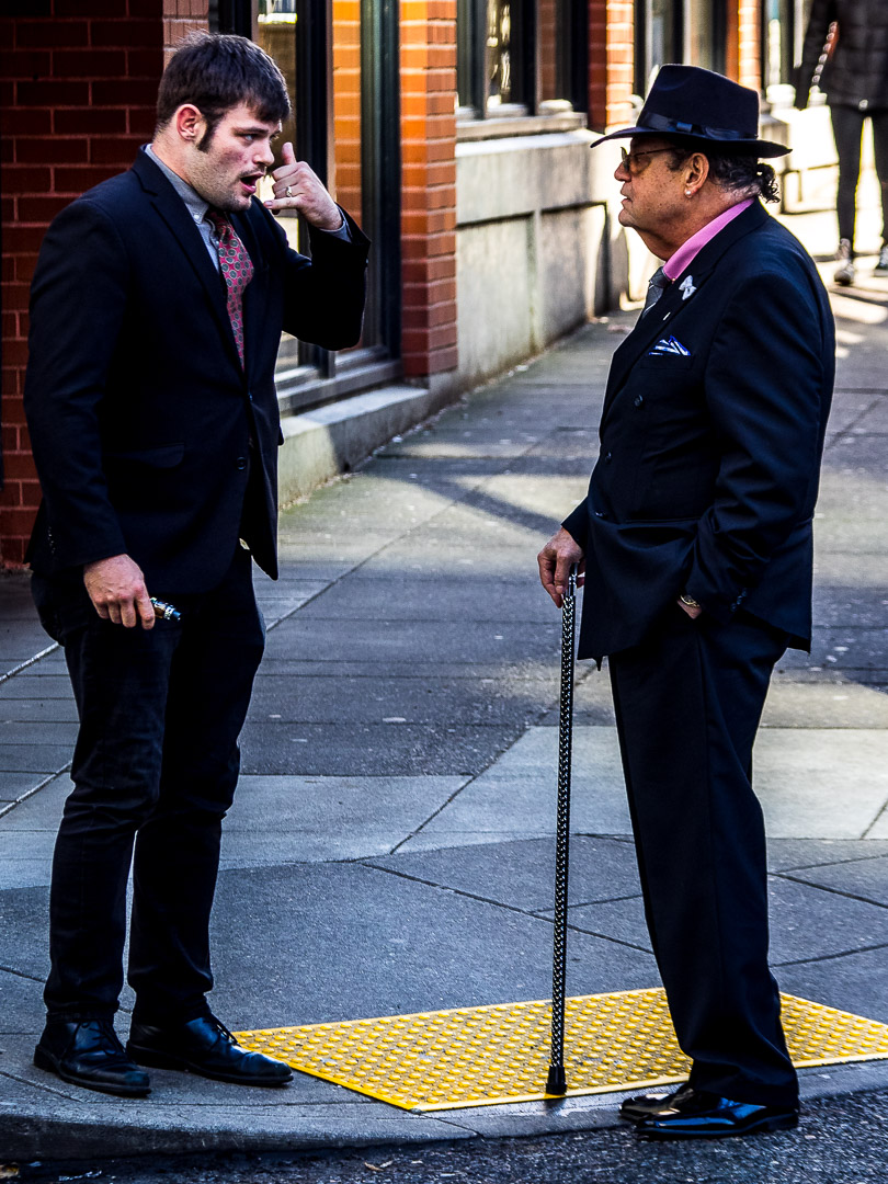 Call Me - Street Photograph of two suit clad men gesturing about calling each other