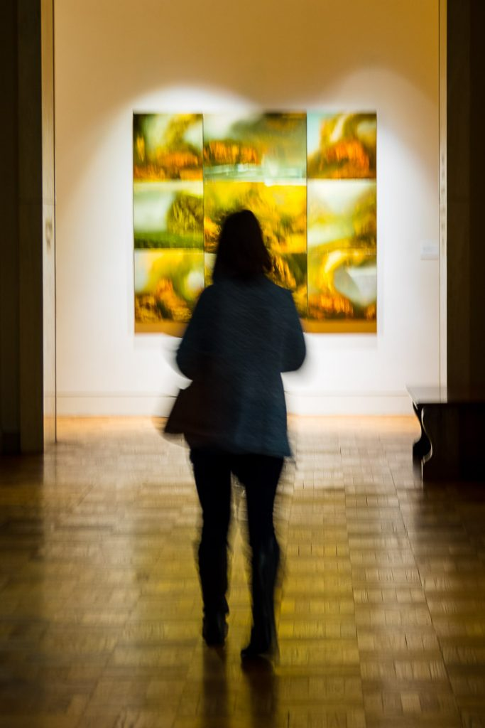 Silhouette of a girl visiting an art museum
