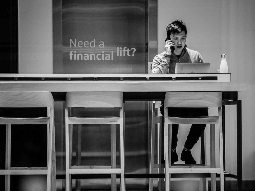 Banker sitting in a bank working