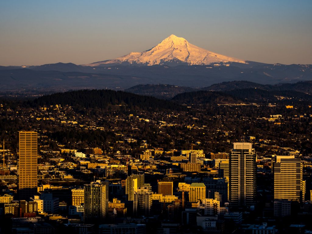 Portlands skyline and Mount Hood glowing golden in the sunset