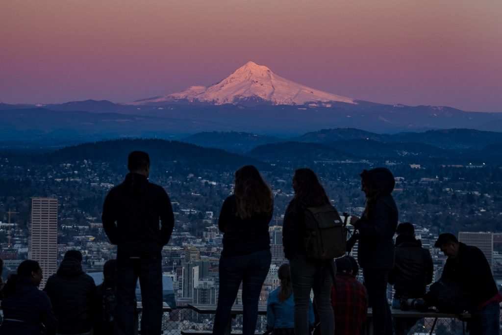 People watching pink Mount Hood from Pittock Mansion