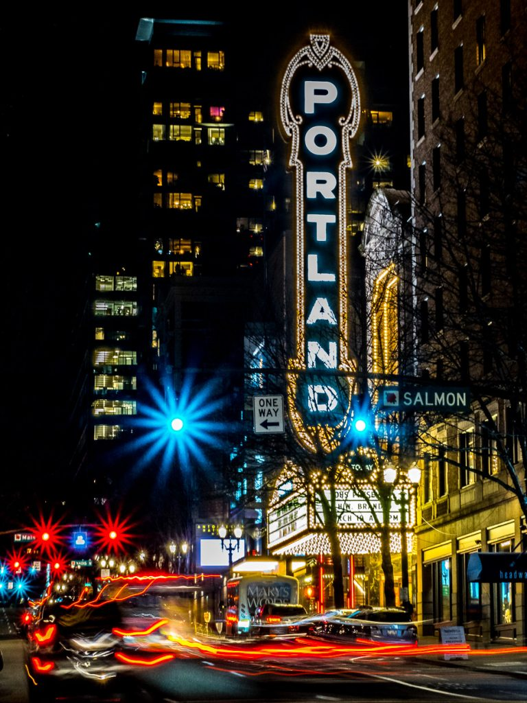 Light trails in front of Portland sign on Broadway