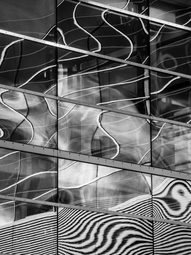 Monochrome photograph of facade reflections