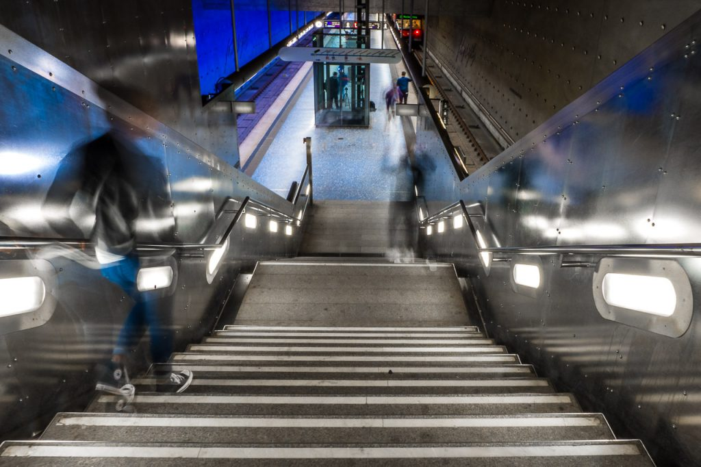 Motion blur view of a passenger descending into a subway station in Nuremberg