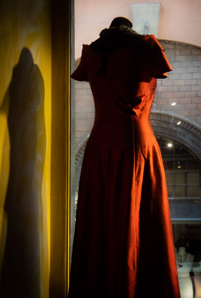 Red dress decorated in a window in Verona