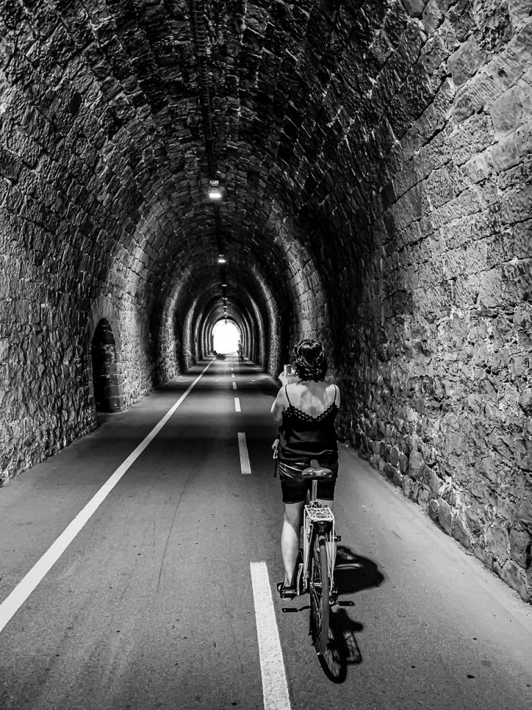 Passing through a former railroad tunnel on a bike