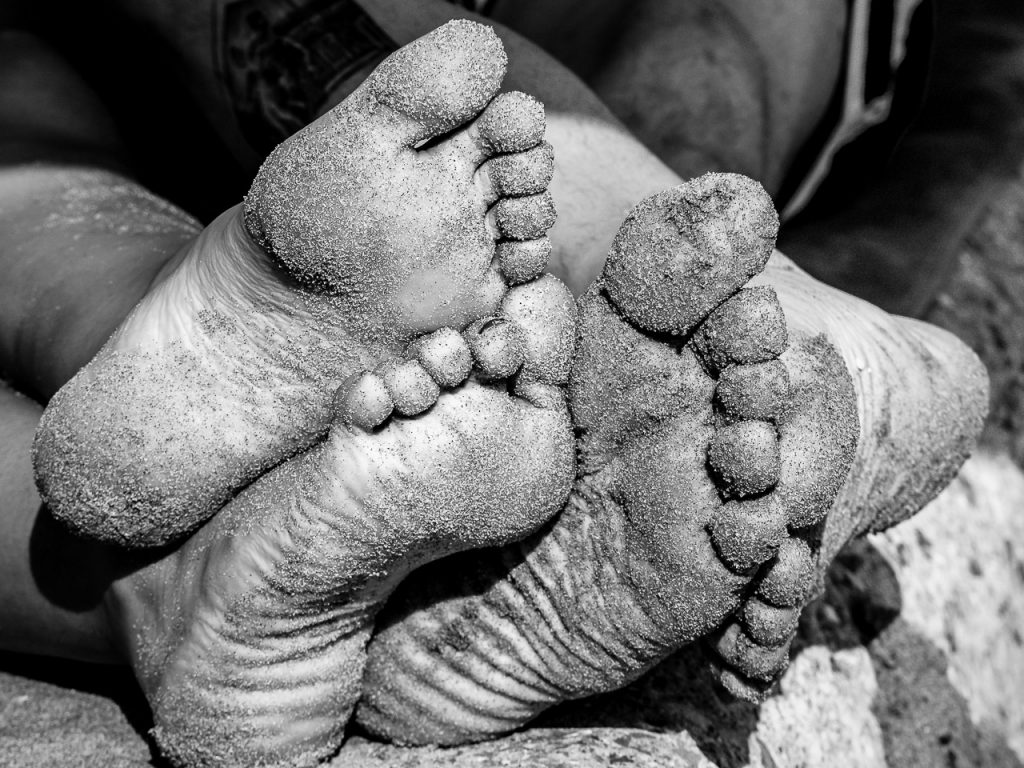 Two pairs of sand covered bare feet - Cee's Black & White Challenge