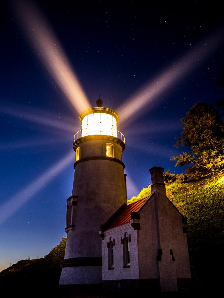 Heceta Head Lighthouse on the Oregon Coast under the night sky