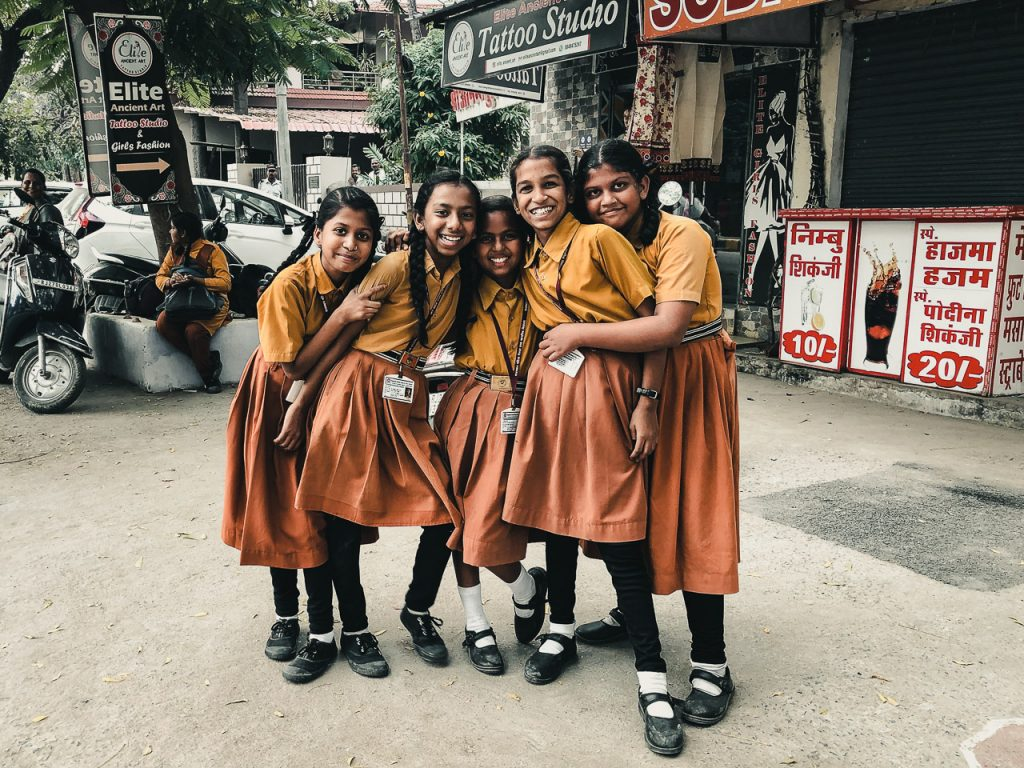 Street photograph of laughing Indian school girls