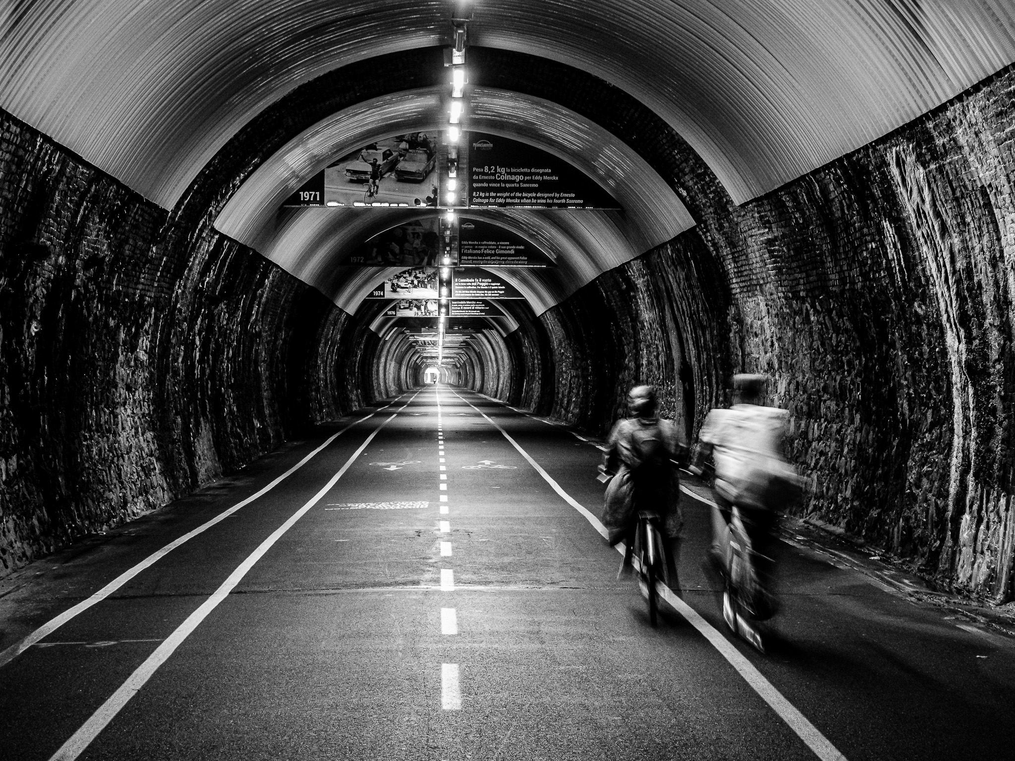 Cyclists in a tunnel
