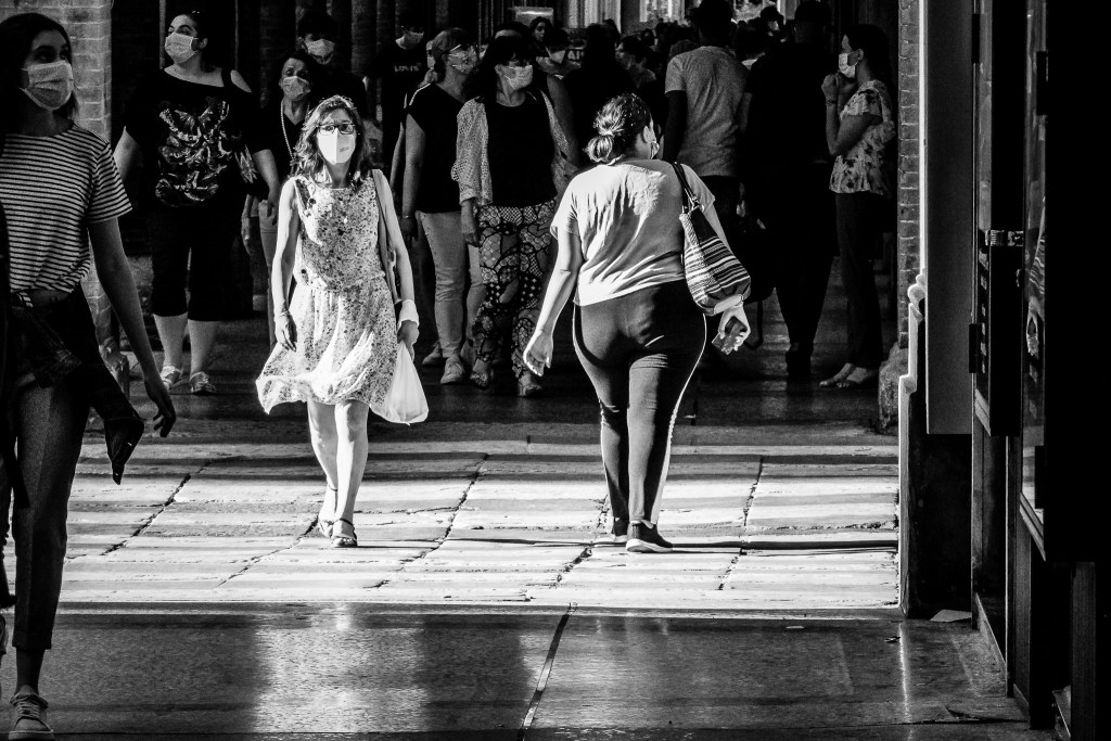 Monochrome street photograph showing the juxtaposition of thin and fat