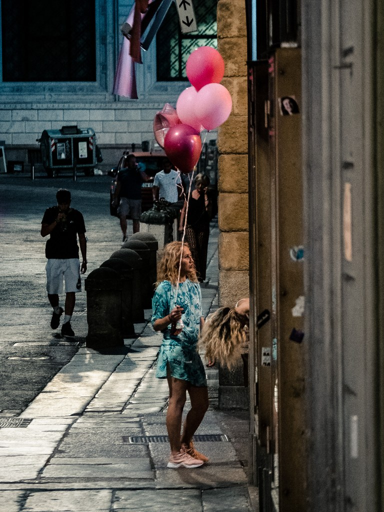 Two young ladies with pink balloons