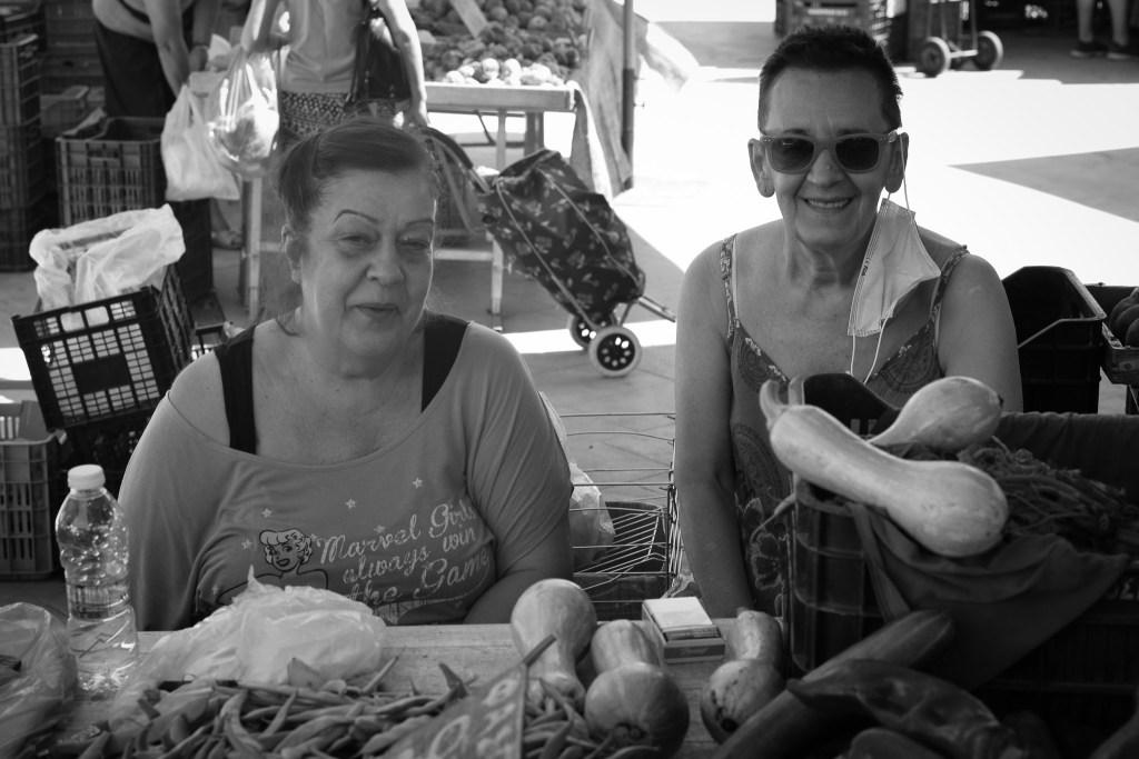 Two ladies selling veggies on the market