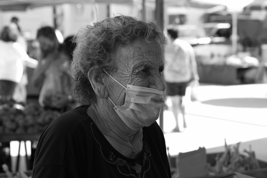 Old lady wearing a mask