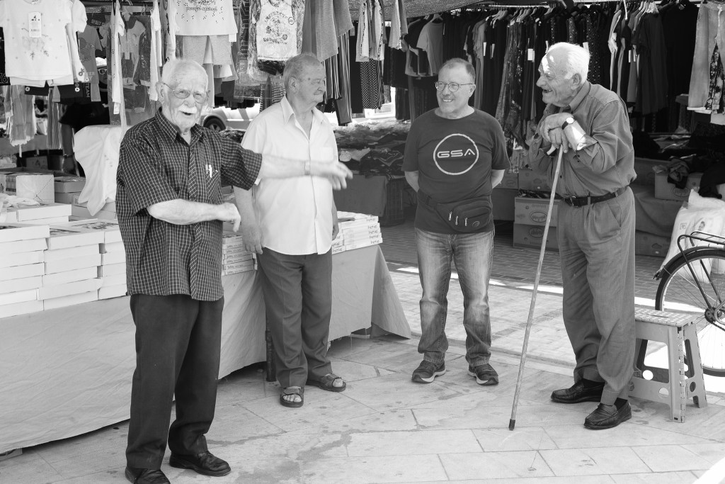 Old men having fun in front of the camera